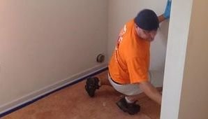 Water Damage Restoration Technician Finishing Up On A Job