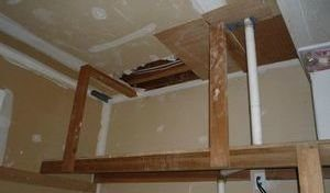 Water Damage Restoration Being Conducted In Flooded Closet