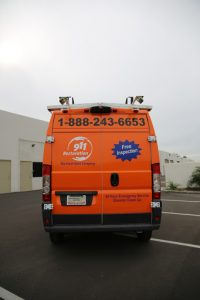 911-restoration-water-damage-mold-remediation-fire-damage-person-van-backangle